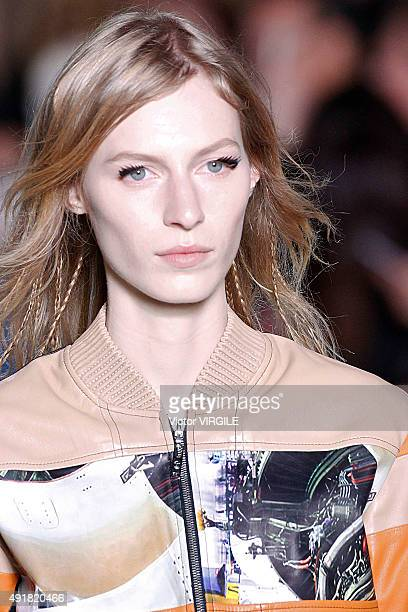 A model walks the runway during the Louis Vuitton Ready to Wear show as part of the Paris Fashion Week Womenswear Spring/Summer 2016 on October 7...