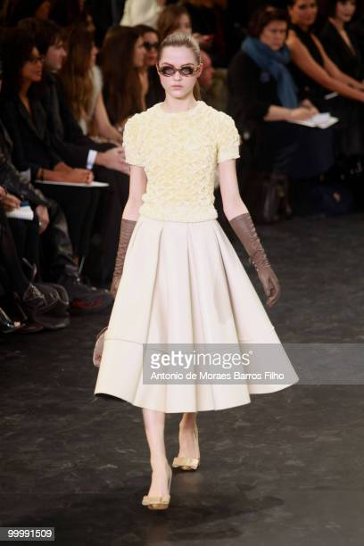 Model walks the runway during the Louis Vuitton Ready to Wear show as part of the Paris Womenswear Fashion Week Fall/Winter 2011 at Cour Carree du...