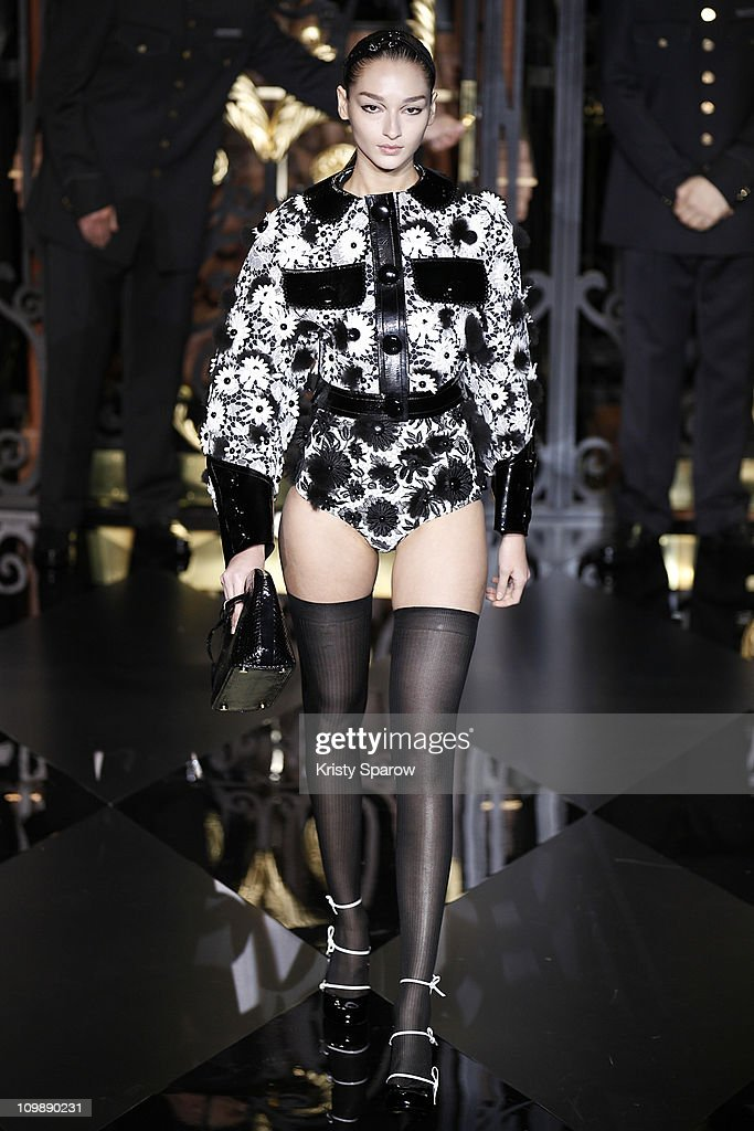 A model walks the runway during the Louis Vuitton Ready to Wear Autumn/Winter 2011/2012 show during Paris Fashion Week at Cour Carree du Louvre on March 9, 2011 in Paris, France.
