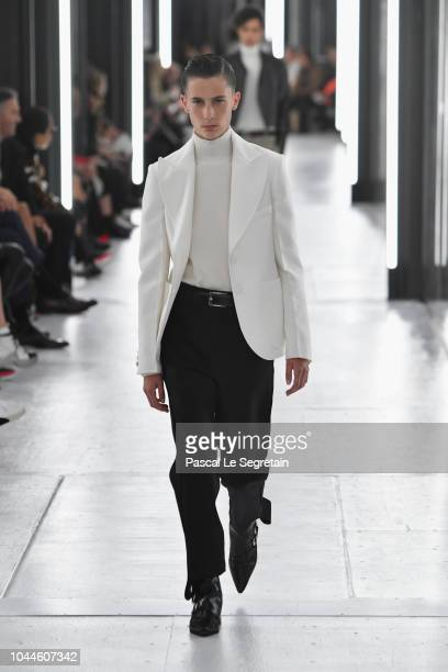 A model walks the runway during the Louis Vuitton show as part of the Paris Fashion Week Womenswear Spring/Summer 2019 on October 2 2018 in Paris...