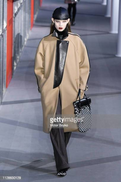 A model walks the runway during the Louis Vuitton show as part of the Paris Fashion Week Womenswear Fall/Winter 2019/2020 on March 5 2019 in Paris...