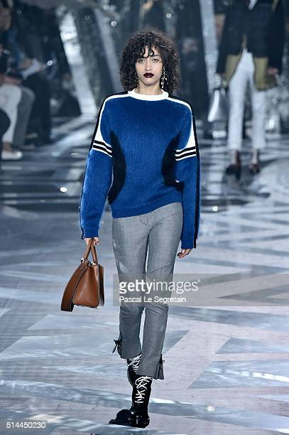 A model walks the runway during the Louis Vuitton show as part of the Paris Fashion Week Womenswear Fall/Winter 2016/2017 on March 9 2016 in Paris...
