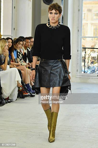 A model walks the runway during the Louis Vuitton show as part of the Paris Fashion Week Womenswear Spring/Summer 2017 on October 5 2016 in Paris...