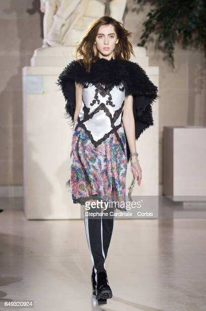 A model walks the runway during the Louis Vuitton show as part of the Paris Fashion Week Womenswear Fall/Winter 2017/2018 on March 7 2017 in Paris...