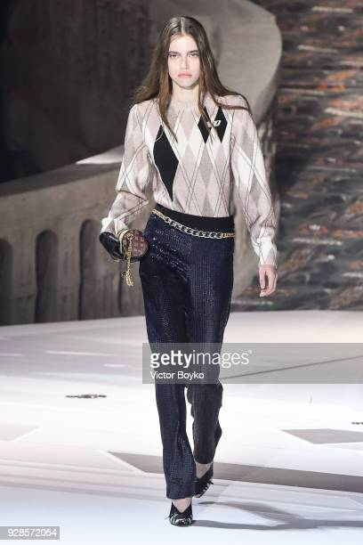 A model walks the runway during the Louis Vuitton show as part of the Paris Fashion Week Womenswear Fall/Winter 2018/2019 on March 6 2018 in Paris...