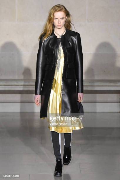 A model walks the runway during the Louis Vuitton show in Musee du Louvre as part of the Paris Fashion Week Womenswear Fall/Winter 2017/2018 on March...