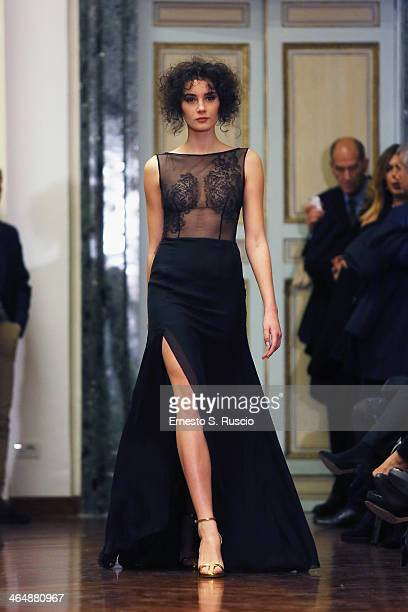 A model walks the runway during the Luigi Borbone fashion show as part of AltaRoma Fashion Week Spring/Summer 2014 on January 24 2014 in Rome Italy