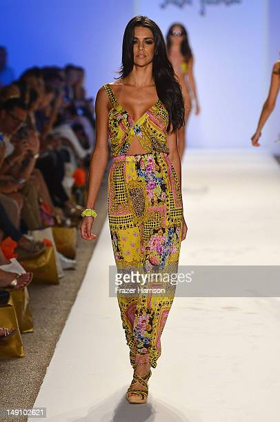 "Model walks the runway during the Luli Fama ""La Dolce Vita Miami"" Collection presented during Mercedes-Benz Fashion Week Swim 2013 at The Raleigh on..."