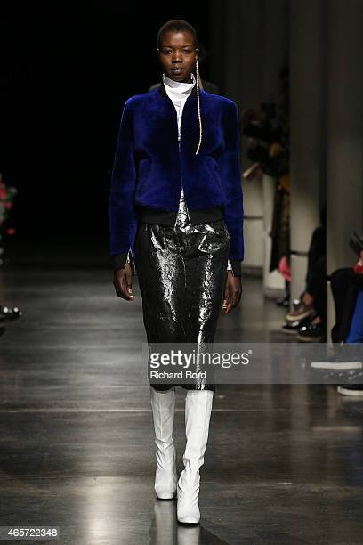 Model walks the runway during the Lutz Huelle show as part of the Paris Fashion Week Womenswear Fall/Winter 2015/2016 at Institut du Monde Arabe on...