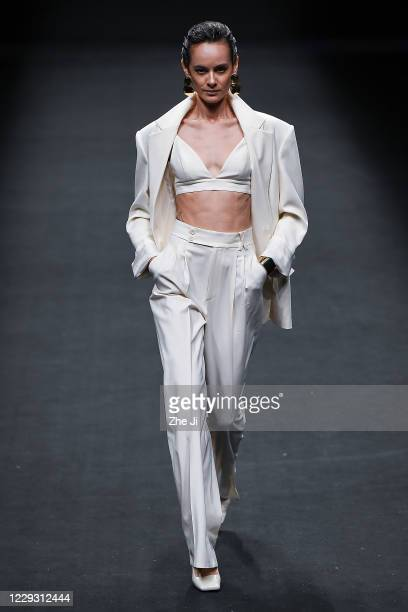 A model walks the runway during the LYNEE collection show by Chinese designer Li Huizhen on day four of China Fashion Week at 751DPARK on October 27...