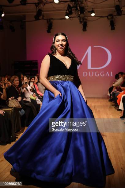 A model walks the runway during the Mac Duggal Fashion Show during NYFW on February 9 2019 in New York City