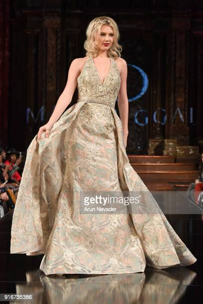 A model walks the runway during the Mac Duggal presentation at New York Fashion Week Powered by Art Hearts Fashion NYFW at The Angel Orensanz...