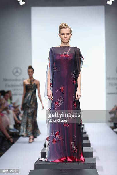 A model walks the runway during the Macario Jimenez show at MercedesBenz Fashion Week Mexico Autumn/Winter 2014 at Campo Marte on April 2 2014 in...
