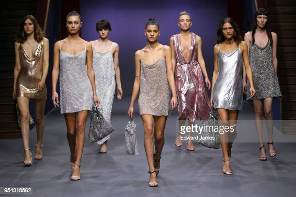 A model walks the runway during the Mach Mach fashion show at MercedesBenz Fashion Week Tbilisi on May 3 2018 in Tbilisi Georgia