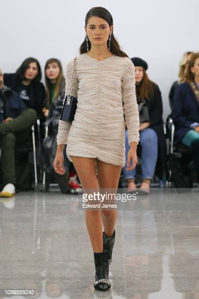 A model walks the runway during the Mach Mach Spring/Summer 2019 Collection fashion show at MercedesBenz Fashion Week Tbilisi on November 2 2018 in...