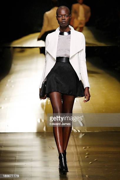 A model walks the runway during the Mackage fashion show at David Pecaut Square on October 23 2013 in Toronto Canada