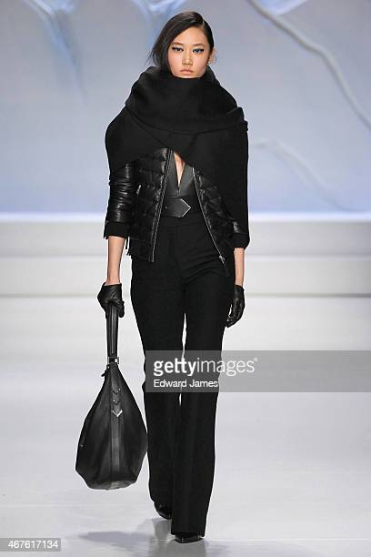 A model walks the runway during the Mackage fashion show at David Pecaut Square on March 25 2015 in Toronto Canada