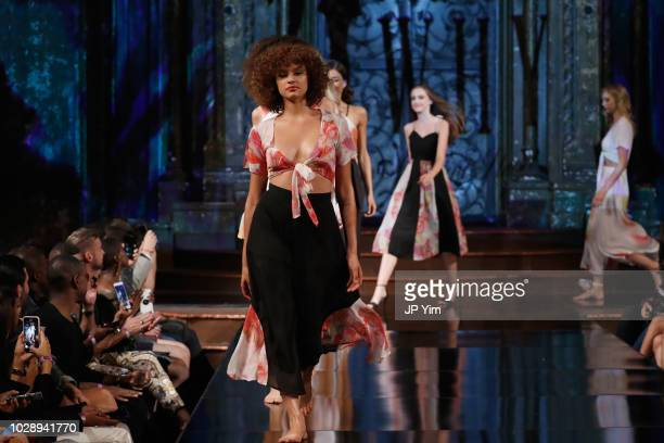 A model walks the runway during the MADELINE STUART 21 REASONS WHY Show At New York Fashion Week Powered By Art Hearts Fashion NYFW at The Angel...