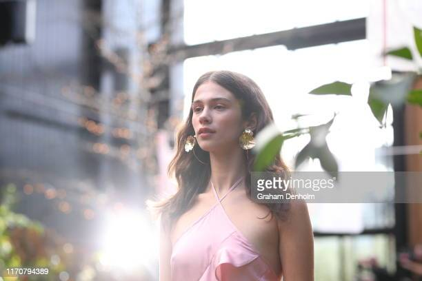 Model walks the runway during the Maggie Marilyn show during New Zealand Fashion Week 2019 at Glasshouse Morningside on August 27, 2019 in Auckland,...