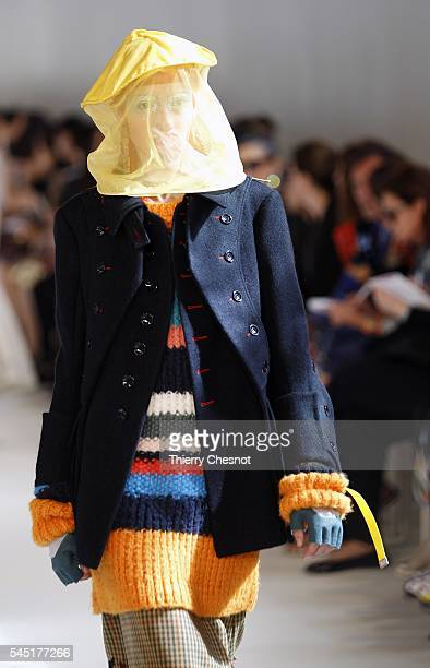 A model walks the runway during the Maison Margiela Haute Couture Fall/Winter 20162017 show as part of Paris Fashion Week on July 6 2016 in Paris...