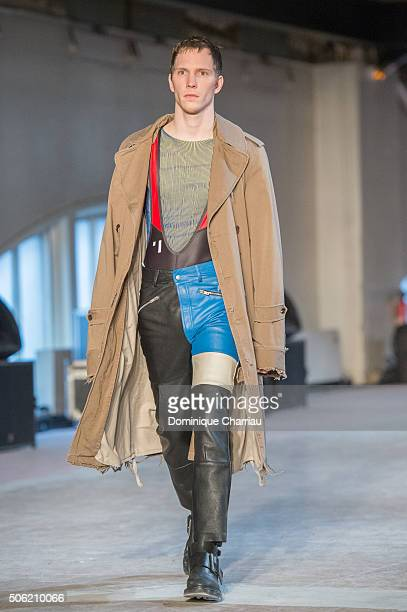 A model walks the runway during the Maison Margiela Menswear Fall/Winter 20162017 show as part of Paris Fashion Week on January 22 2016 in Paris...
