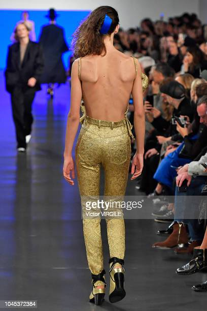 A model walks the runway during the Maison Margiela Ready to Wear fashion show as part of the Paris Fashion Week Womenswear Spring/Summer 2019 on...