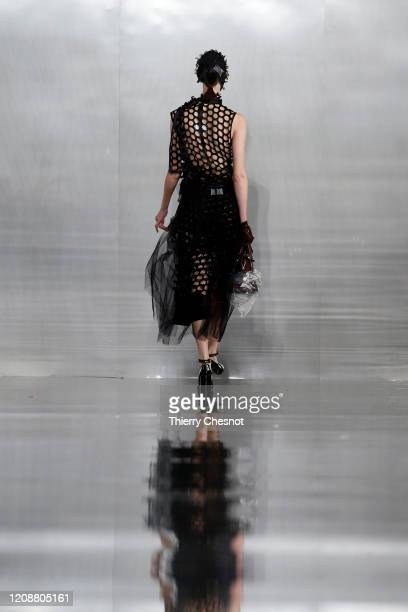 Model walks the runway during the Maison Margiela show as part of the Paris Fashion Week Womenswear Fall/Winter 2020/2021 on February 26, 2020 in...