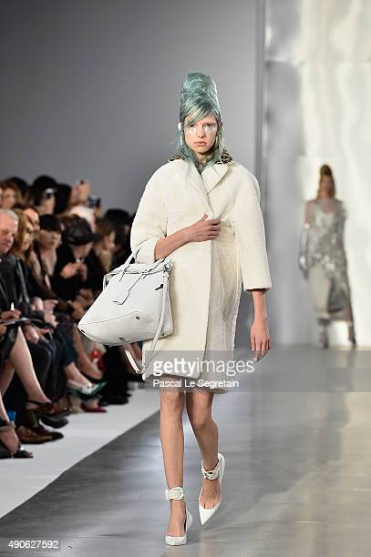 Model walks the runway during the Maison Margiela show as part of the Paris Fashion Week Womenswear Spring/Summer 2016 on September 30, 2015 in...