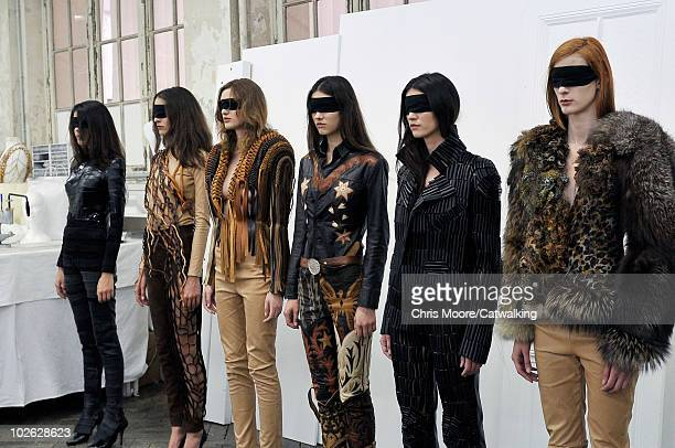 Model walks the runway during the Maison Martin Margiela fashion presentation at Paris Haute Couture Fashion Week for Autumn Winter 2010 on July 5,...