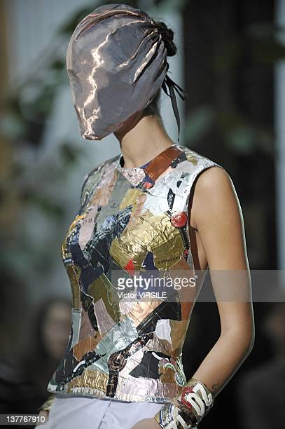 Model walks the runway during the Maison Martin Margiela Haute Couture 2012 show as part of the Paris Haute couture Week on January 25, 2012 in...