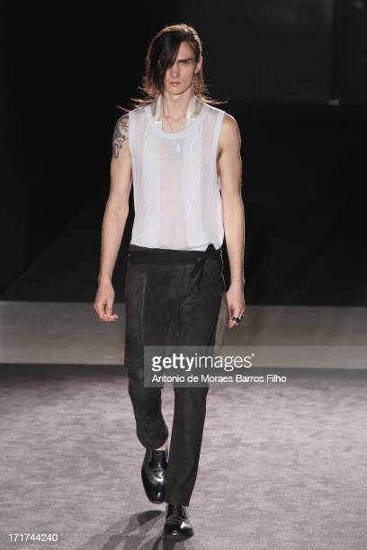 A model walks the runway during the Maison Martin Margiela Menswear Spring/Summer 2014 Show As Part Of The Paris Fashion Week on June 28 2013 in...