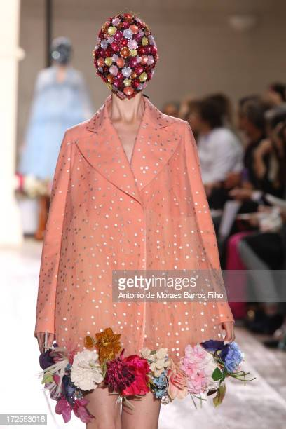 Model walks the runway during the Maison Martin Margiela show as part of Paris Fashion Week Haute-Couture Fall/Winter 2013-2014 at on July 3, 2013 in...