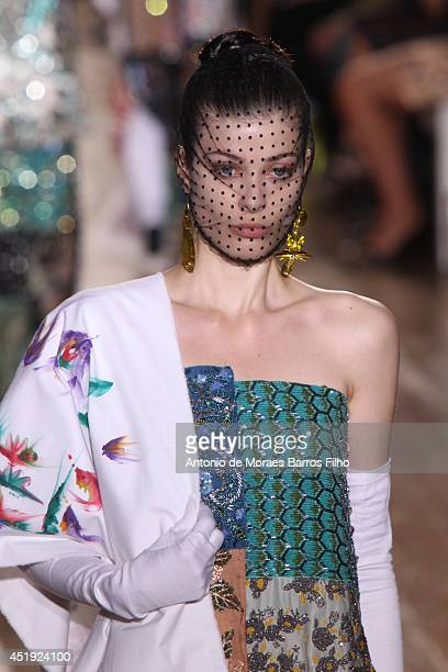 Model walks the runway during the Maison Martin Margiela show as part of Paris Fashion Week - Haute Couture Fall/Winter 2014-2015 at on July 9, 2014...