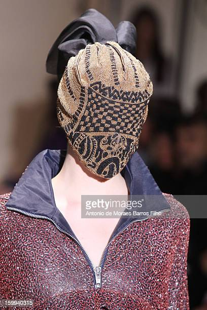 Model walks the runway during the Maison Martin Margiela Spring/Summer 2013 Haute-Couture show as part of Paris Fashion Week at on January 23, 2013...