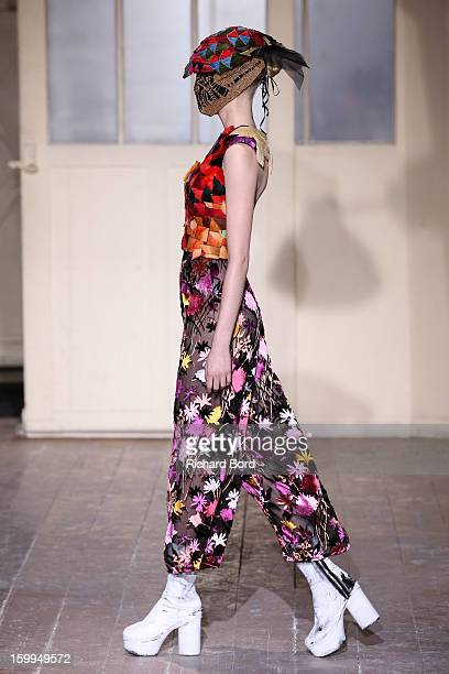 A model walks the runway during the Maison Martin Margiela Spring/Summer 2013 HauteCouture show as part of Paris Fashion Week at on January 23 2013...