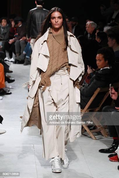 A model walks the runway during the Maison Mihara Yasuhiro Menswear Fall/Winter 20162017 show as part of Paris Fashion Week on January 22 2016 in...