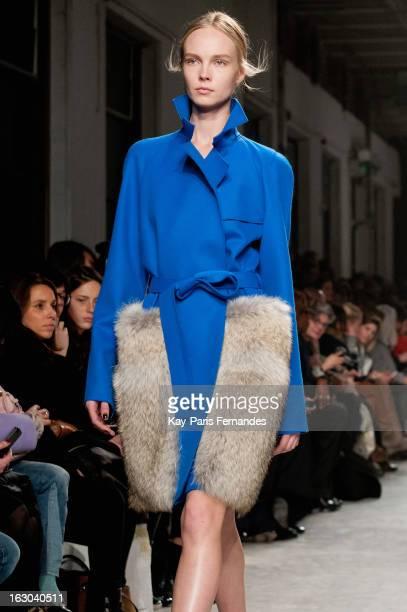A model walks the runway during the Maison Rabih Kayrouz Fall/Winter 2013 ReadytoWear show as part of Paris Fashion Week at the Palais De Tokyo on...