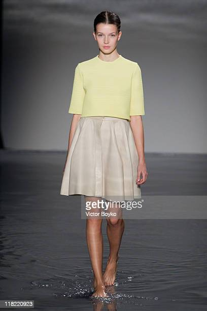A model walks the runway during the Maison Rabih Kayrouz Haute Couture Fall/Winter 2011/2012 show as part of Paris Fashion Week at Couvent des...