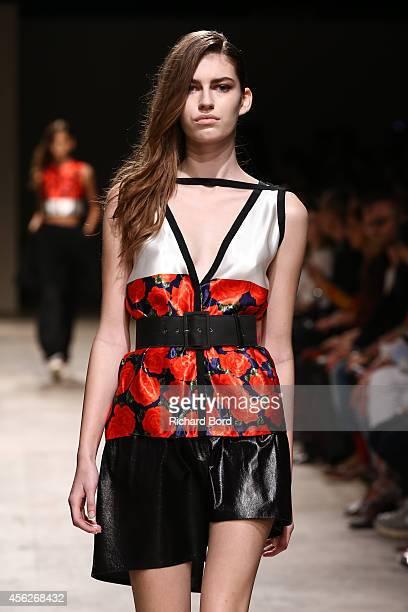 A model walks the runway during the Maison Rabih Kayrouz show as part of the Paris Fashion Week Womenswear Spring/Summer 2015 at Palais de Tokyo on...