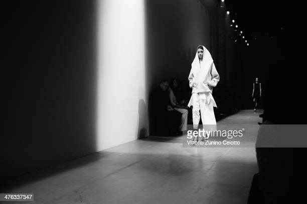 A model walks the runway during the Maison Rabih Kayrouz show as part of the Paris Fashion Week Womenswear Fall/Winter 20142015 at Palais de Tokio on...