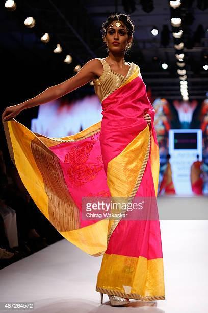 A model walks the runway during the Mandira Bedi show on day 5 of Lakme Fashion Week Summer/Resort 2015 at Palladium Hotel on March 22 2015 in Mumbai...