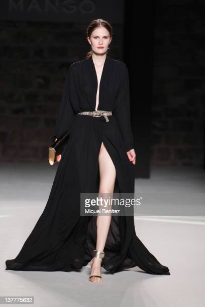 A model walks the runway during the Mango fashion show as part of the 080 BCN Fashion Week Fall/Winter 20122013 show on January 26 2012 in Barcelona...