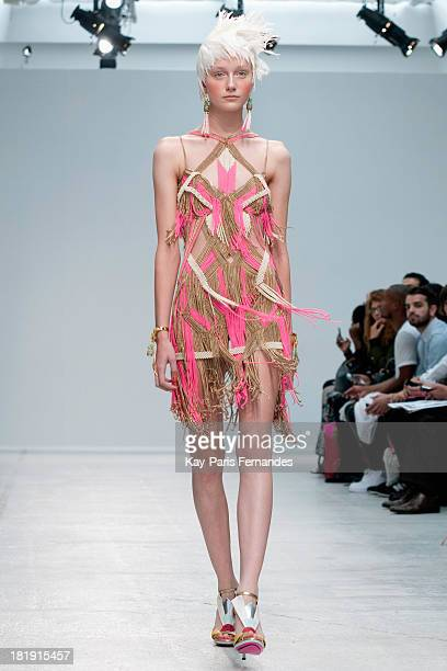 Model walks the runway during the Manish Arora show as part of the Paris Fashion Week Womenswear Spring/Summer 2014 at the Palais De Tokyo on...