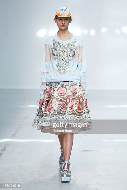 Model walks the runway during the Manish Arora show as part of the Paris Fashion Week Womenswear Spring/Summer 2015 on September 25, 2014 in Paris,...