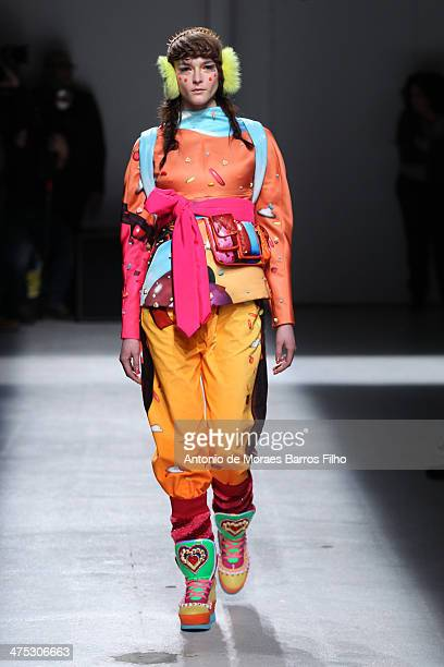 A model walks the runway during the Manish Arora show as part of the Paris Fashion Week Womenswear Fall/Winter 20142015 on February 27 2014 in Paris...