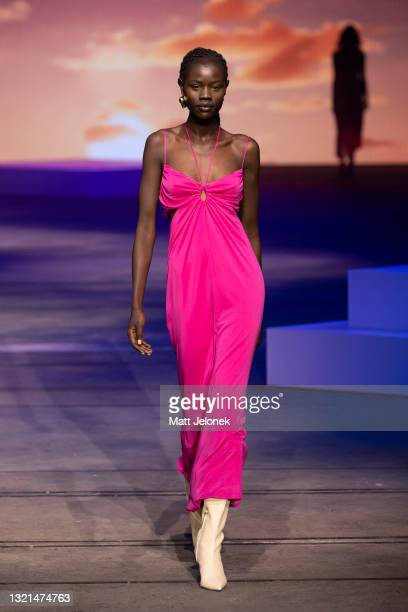 Model walks the runway during the Manning Cartell show during Afterpay Australian Fashion Week 2021 Resort '22 Collections at Carriageworks on June...