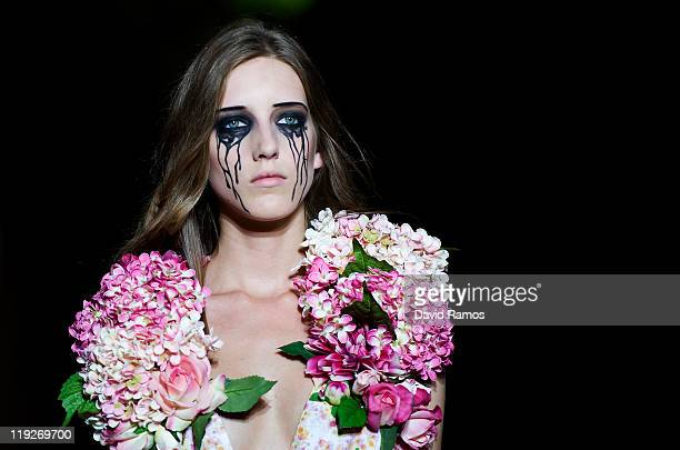 A model walks the runway during the Manuel Bolano catwalk show as part of the 080 Barcelona Fashion week on July 15 2011 in Barcelona Spain