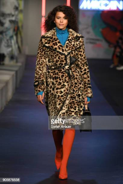 A model walks the runway during the Marc Cain Fashion Show Berlin Autumn/Winter 2018 at metro station Potsdamer Platz on January 16 2018 in Berlin...
