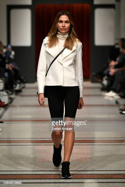 A model walks the runway during the Marc Cain Fashion Show Berlin Autumn/Winter 2019 at Deutsche Telekom's representative office on January 15 2019...