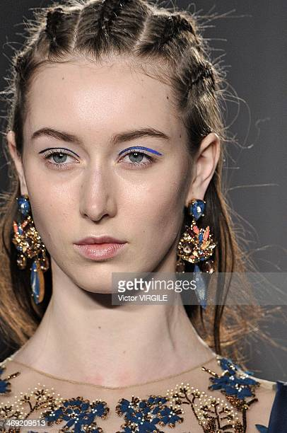 A model walks the runway during the Marchesa Ready to Wear Fall/Winter 20142015 show during MercedesBenz Fashion Week Fall 2014 on February 12 2014...